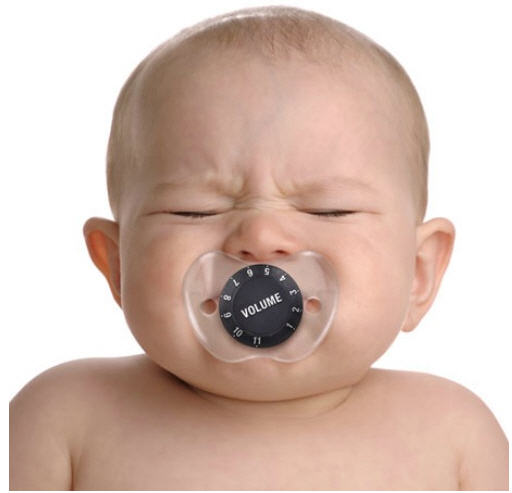 Crying baby with pacifier