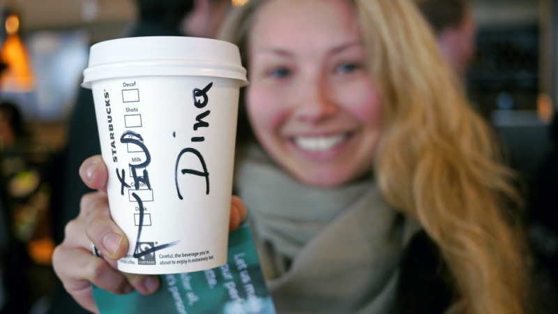 Happy Customer with Name on Coffee Cup